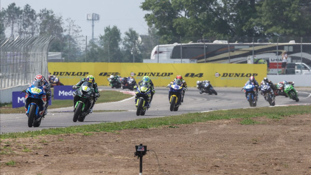 Sean Dylan Kelly (40) leads Richie Escalante (1), Rocco Landers (97), and the rest of the Supersport pack early in Saturday's Supersport final at Brainerd International Raceway. Photo by Brian J. Nelson.