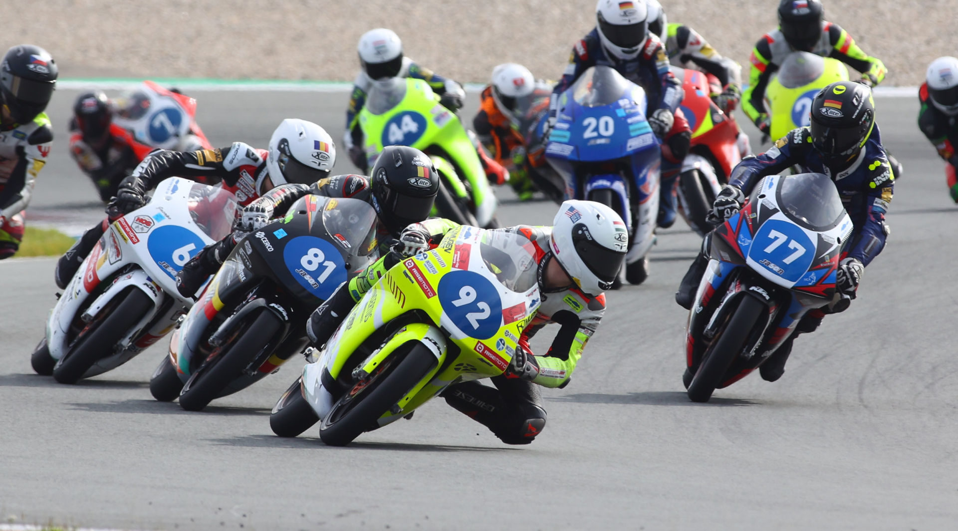 Hungarian-American Rossi Moor (92) leads Lorenz Luciano (81) and the rest of the Northern Talent Cup Field during Race One at Red Bull Ring, in Austria. Photo courtesy Dorna.