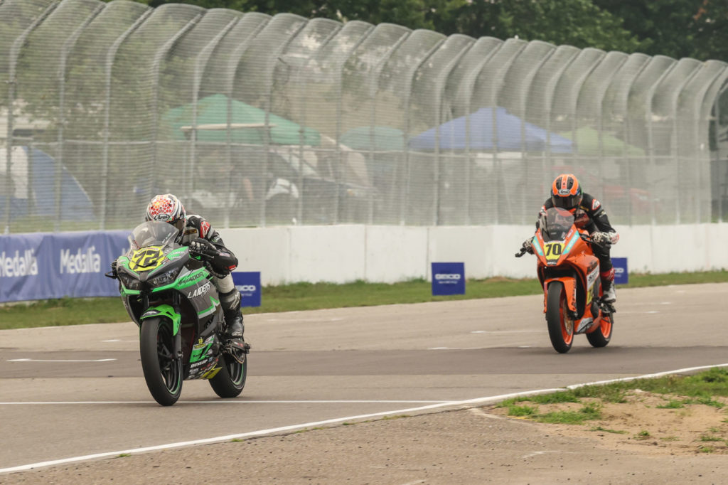 Ben Gloddy (32) leads Tyler Scott (70) during a MotoAmerica Junior Cup race at Brainerd. Photo by Brian J. Nelson, courtesy Landers Racing.