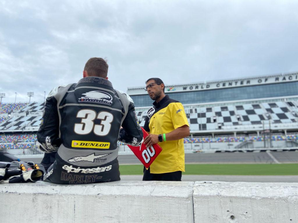 Kyle Wyman (left) working with Dunlop tire engineer Tony Romo (right) on pit lane at Daytona International Speedway. Photo courtesy Kyle Wyman.