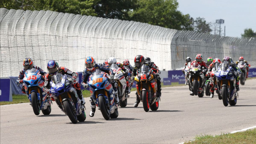 Jake Gagne (32) and Bobby Fong (50) get close off the start of Sunday's HONOS Superbike race at Brainerd International Raceway with Cameron Petersen (45), Mathew Scholtz (11), and JD Beach (69) giving chase. Photo by Brian J. Nelson.