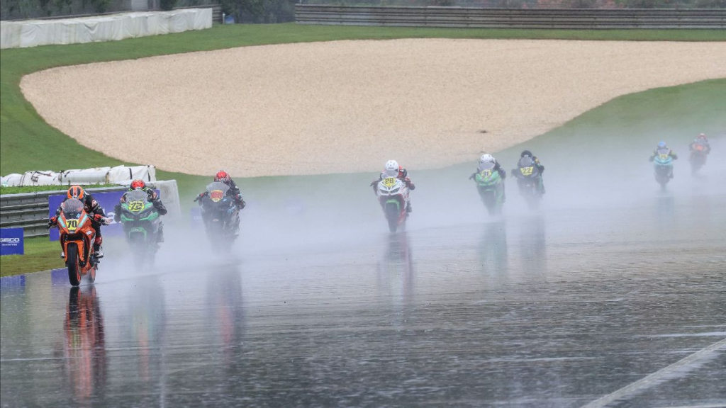 Tyler Scott (70) leads Ben Gloddy (72) and the rest of the field during the SportbikeTrackGear.com Junior Cup race, which was held in a rainstorm at Barber Motorsports Park. Photo by Brian J. Nelson, courtesy MotoAmerica.