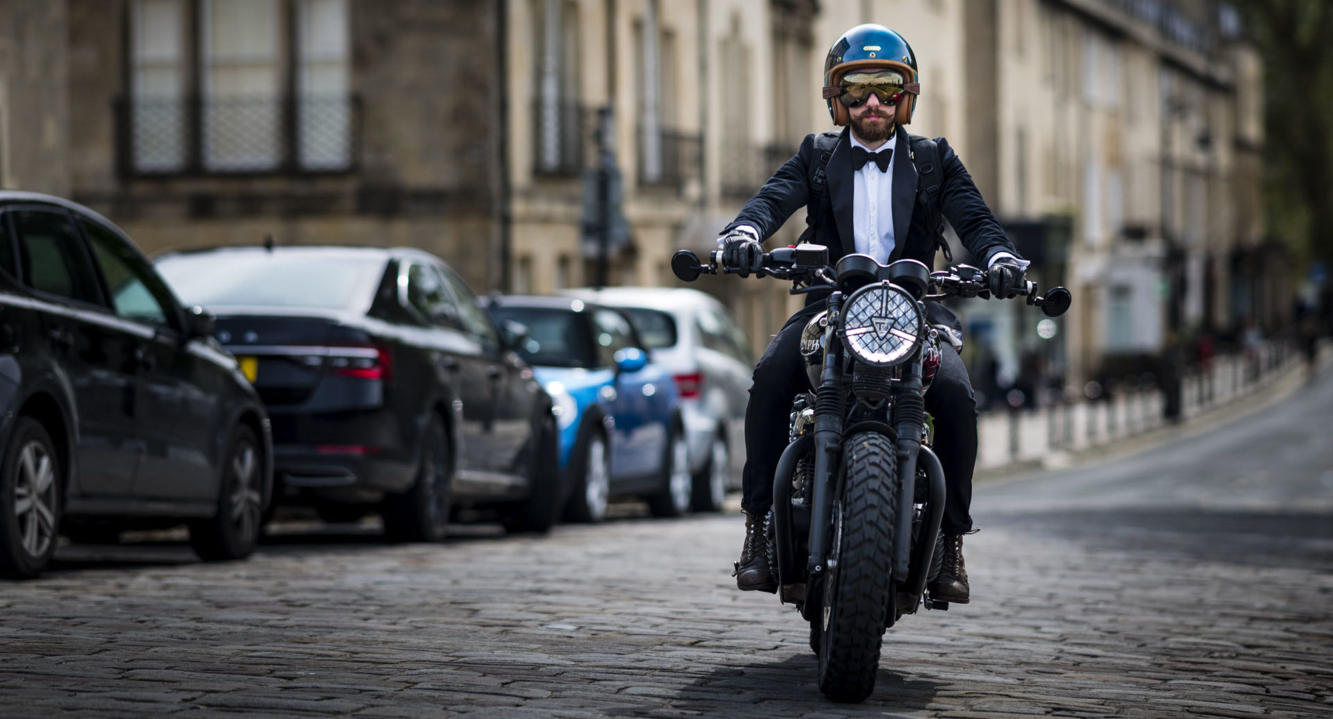 A well dressed participant on a Triumph motorcycle during a Distinguished Gentleman's Ride in England. Photo courtesy Triumph.