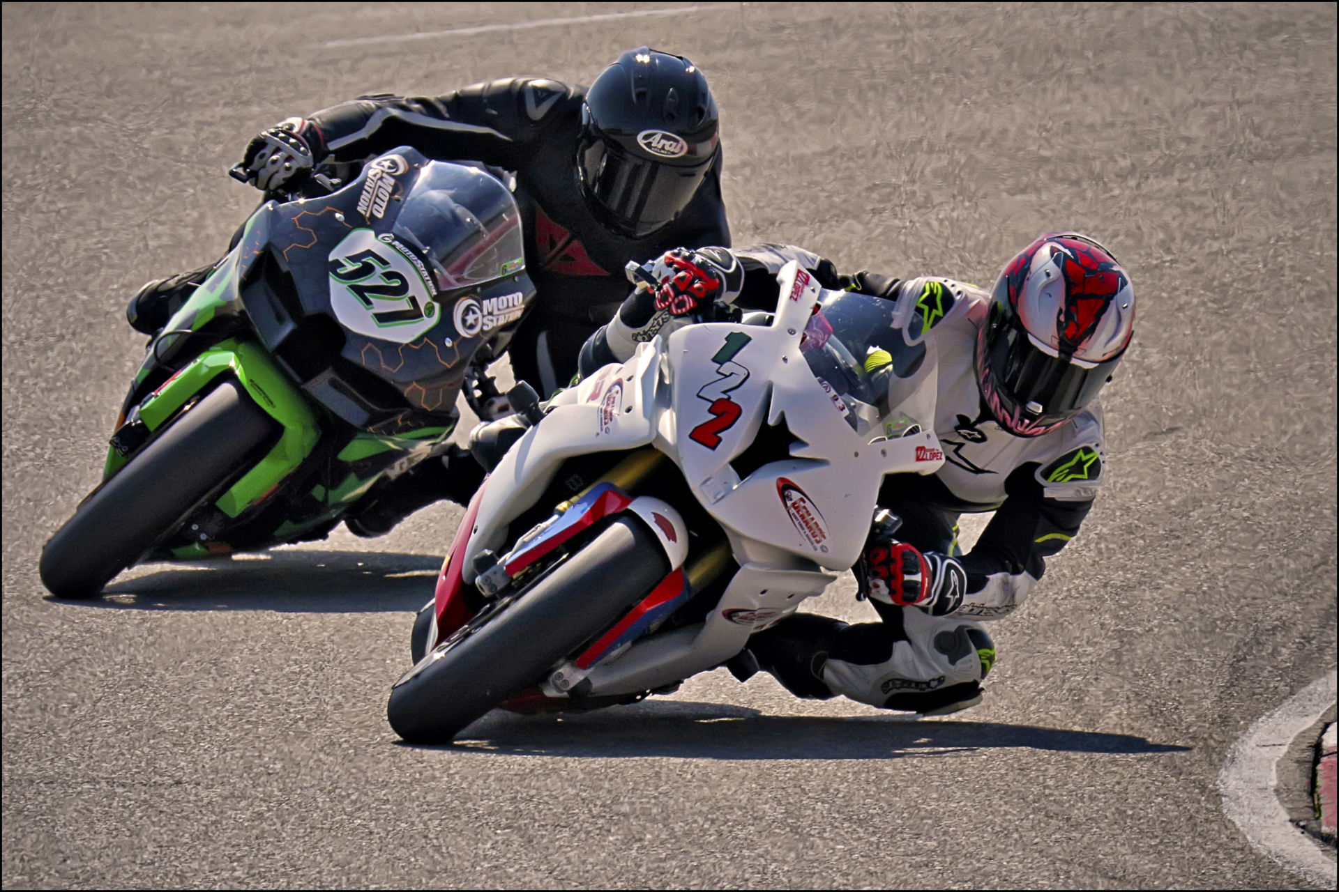 Genaro Lopez (122) fends off Jerry Hicks (527) in the final corner during Round 6 of the UtahSBA's King of the Mountain Race held at Utah Motorsports Campus' East Track. Photo by Steve Midgley, courtesy UtahSBA.