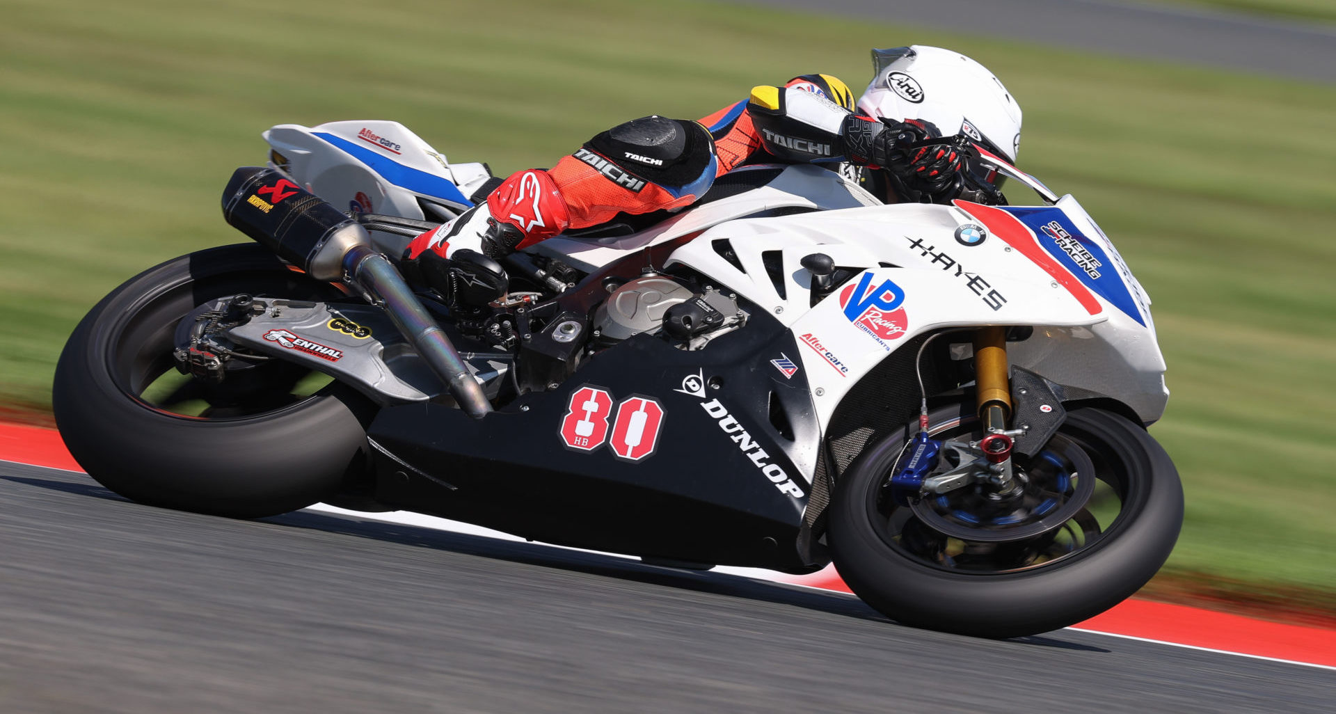 Hector Barbera (80) at speed on his Aftercare BMW S1000RR Superbike. Photo by Brian J. Nelson, courtesy Scheibe Racing.