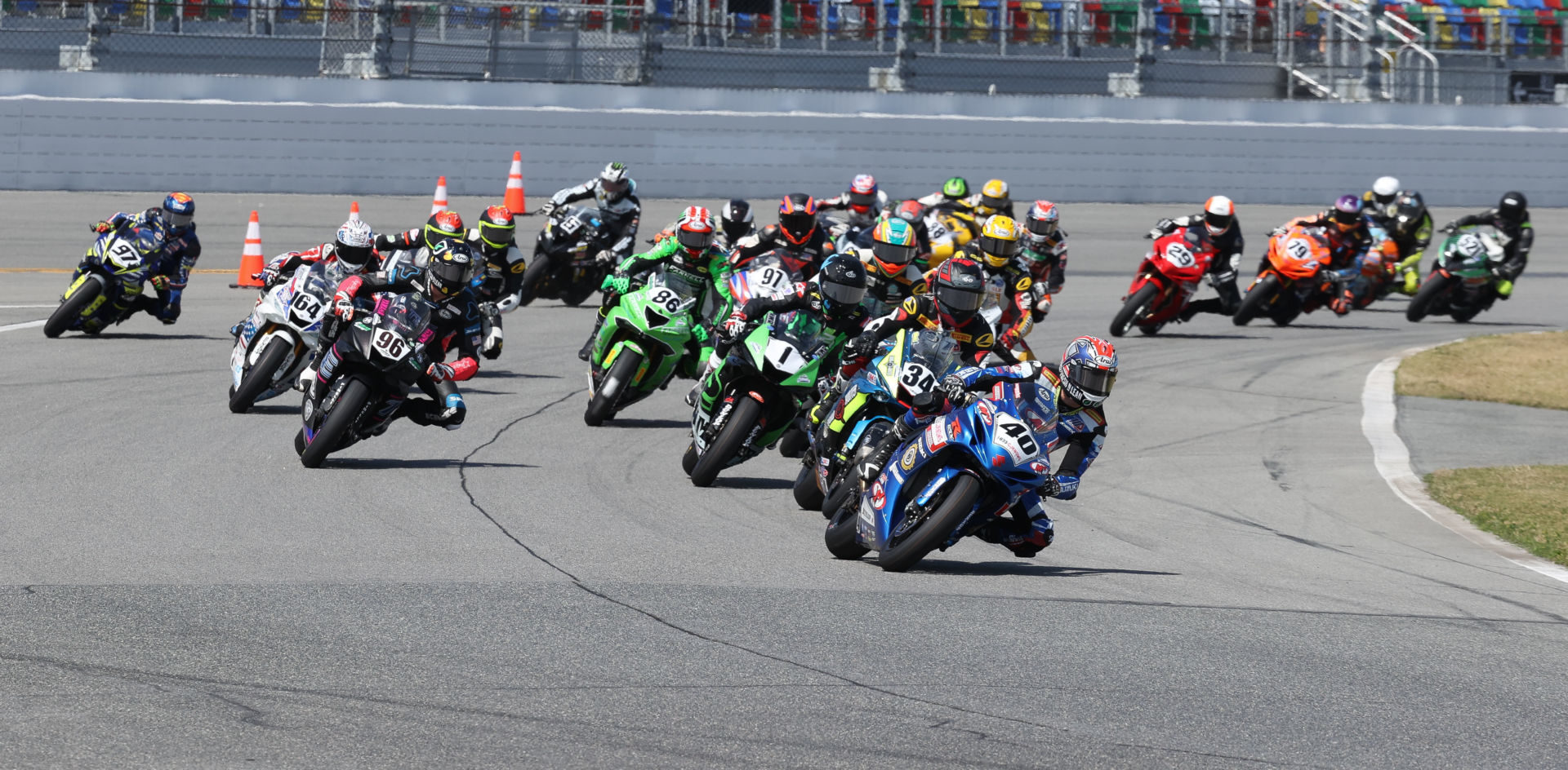 Sean Dylan Kelly (40) leads Michael Barnes (34), Kyle Wyman (1), Brandon Paasch (96), and the rest of the field at the start of the 79th Daytona 200, in 2021. Photo by Brian J. Nelson.