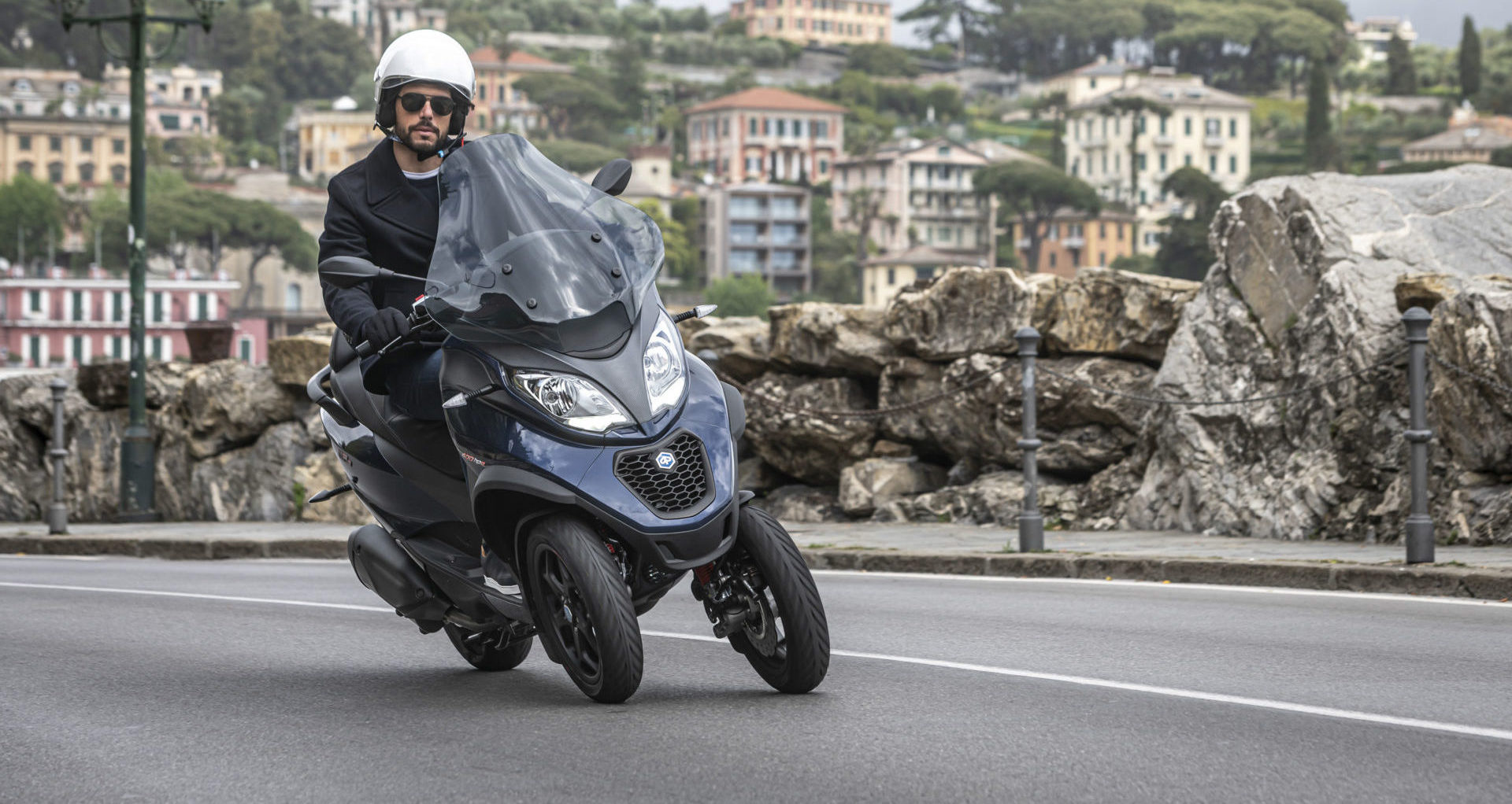A Piaggio MP3 three-wheel scooter, which has a patented front wheel tilting system. Photo courtesy Piaggio Group.
