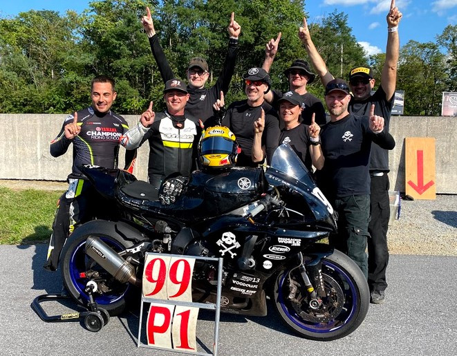The 2021 N2/WERA National Endurance Overall Champions Army Of Darkness (from left): Chris Peris, Ben Walters, Chris Manfrin, Sam Fleming, Melissa Berkoff, Tim Gooding, YT Lechner, and Anthony Consorte. Photo courtesy Army of Darkness.