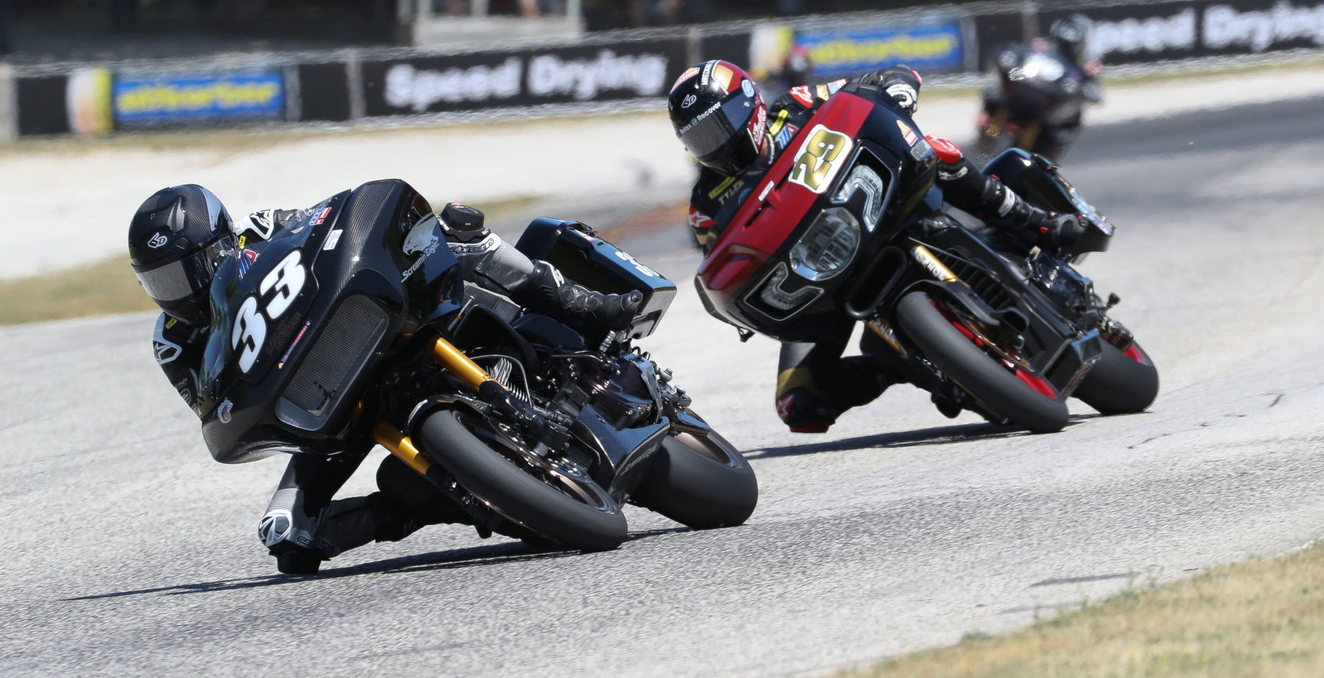 Kyle Wyman (33) and Tyler O'Hara (29) racing for the lead of the King Of The Baggers race at Road America in 2021. Photo by Brian J. Nelson.