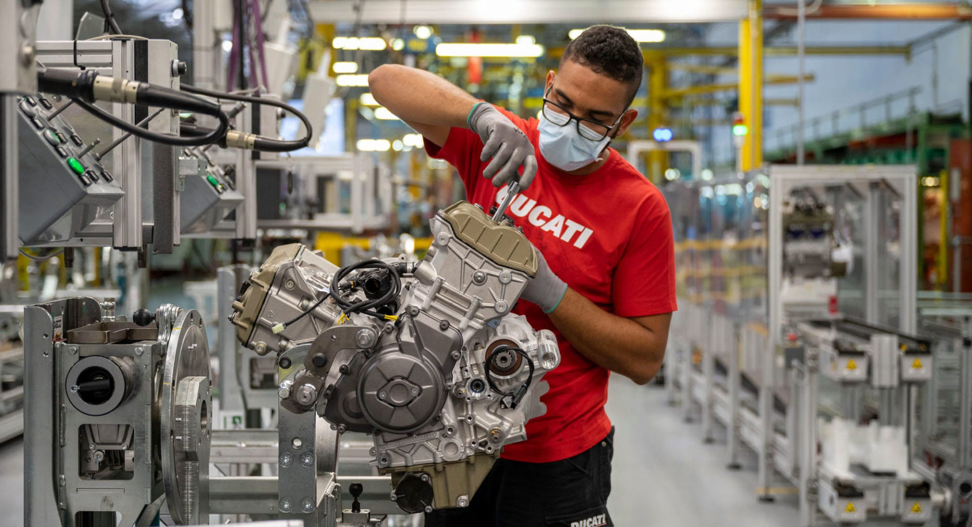 A worker assembling an engine on the production line at the Ducati factory in Italy. Photo courtesy Ducati.