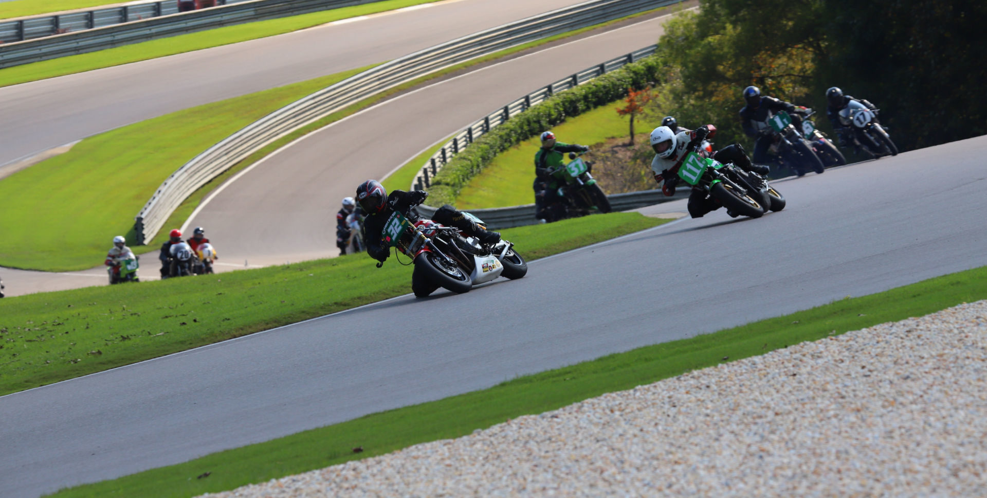 Action from the AHRMA Vintage Superbike Heavyweight race on October 9 with Dale Quarterley (32Q) leading David Crussell (117), Dennis Parrish (1R), Kenny Cummings (17), Martin Jarusek (31), and Curtis Adams (045) into Turn Two at Barber Motorsports Park. Photo by etechphoto.com, courtesy AHRMA.
